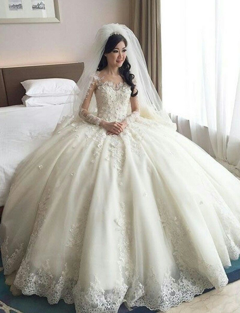This beautiful long sleeve wedding gown has a cinderella feel and