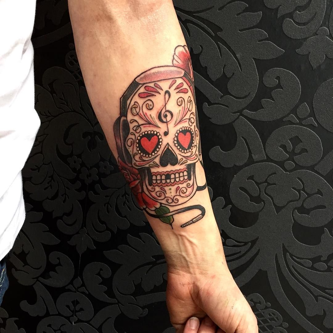 Sugar skull tattoo on mans forearm with love rose and music sugar skull tattoo on mans forearm with love rose and music symbols biocorpaavc Images