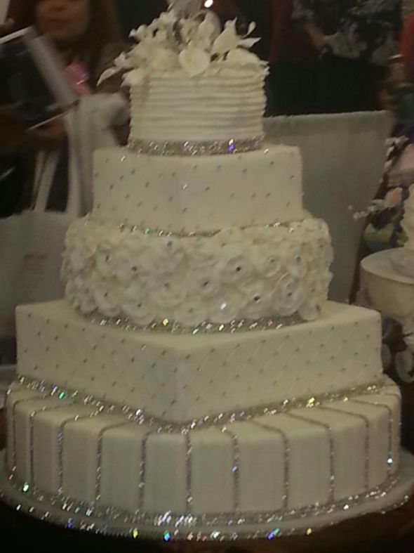 A Four Tier Bling Wedding Cake Decorated With Rhinestone Diamante Bands Swarovski Crystals And