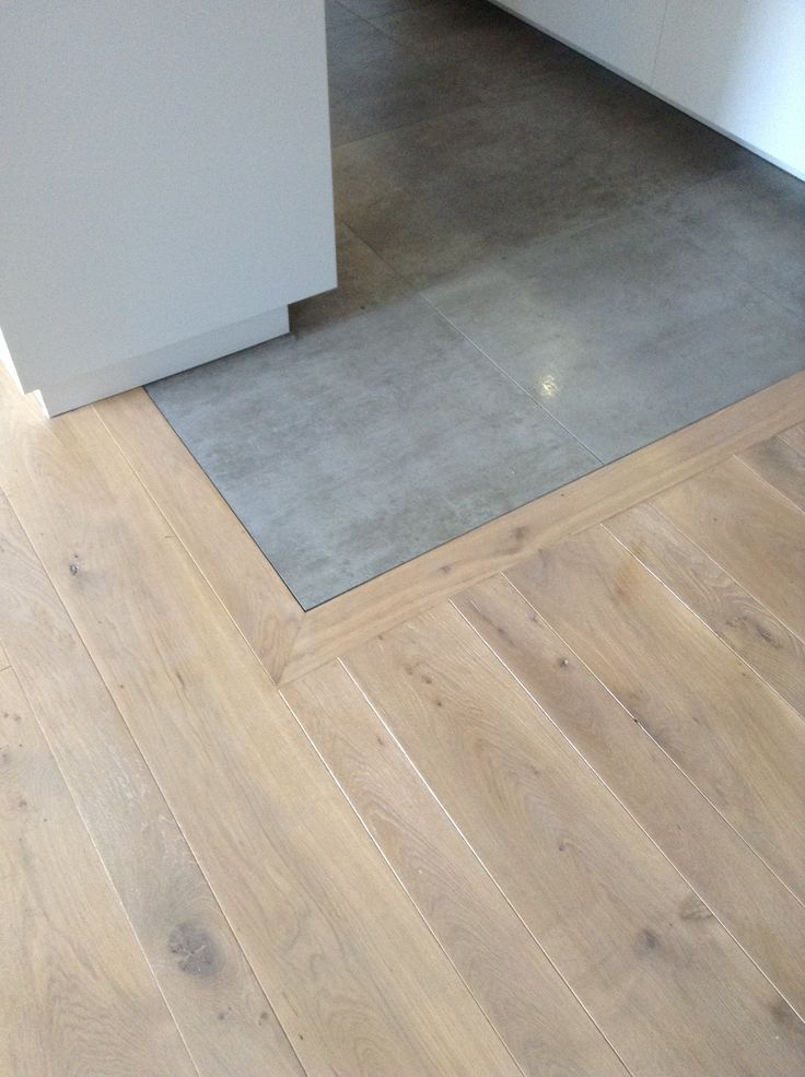 Photo of Attach tiles and swell wooden floors. Flooring home deco
