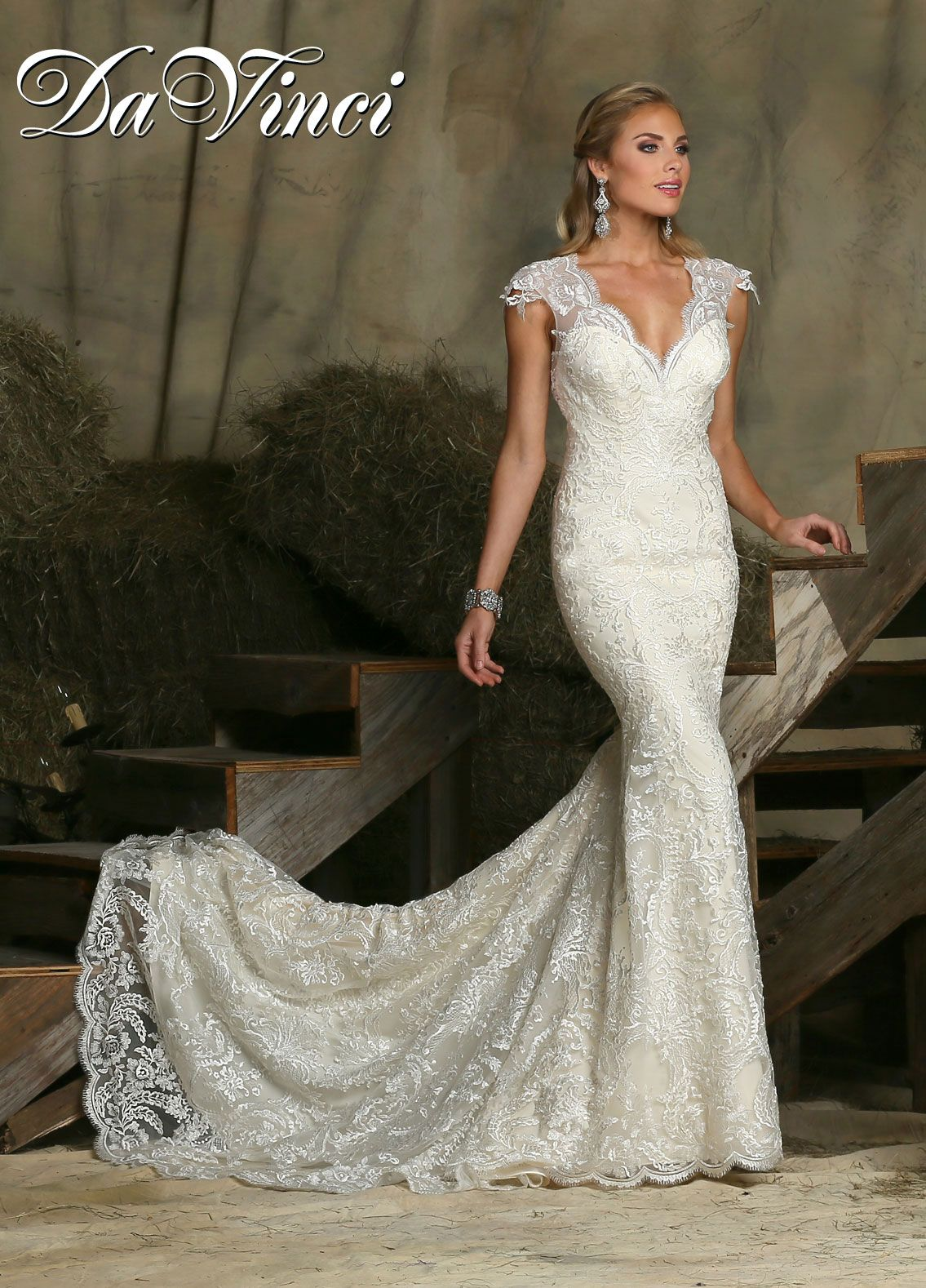 DaVinci Bridal Style 50329 is a Vneck lace wedding dress with an ...
