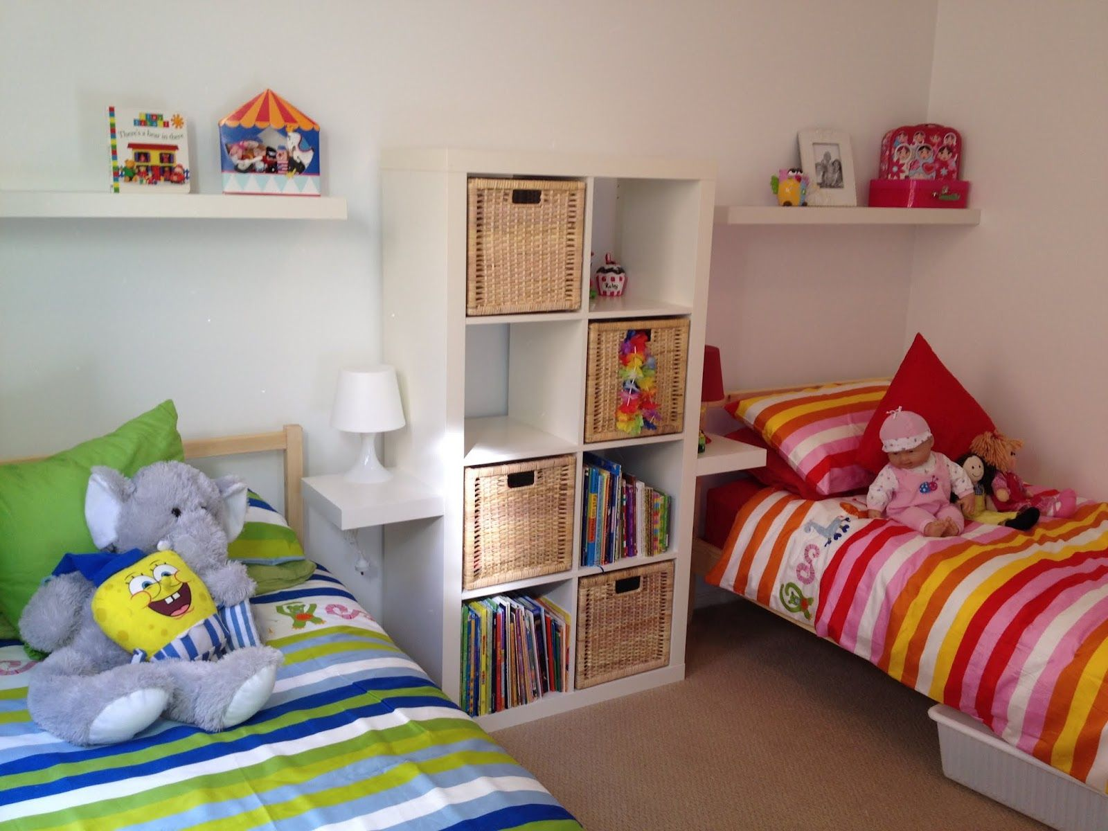 Shared boys bedroom designs - Amazing Boy And Girl Room Ideas With Dolls On The Twin Bed Combined With White Bookshelves