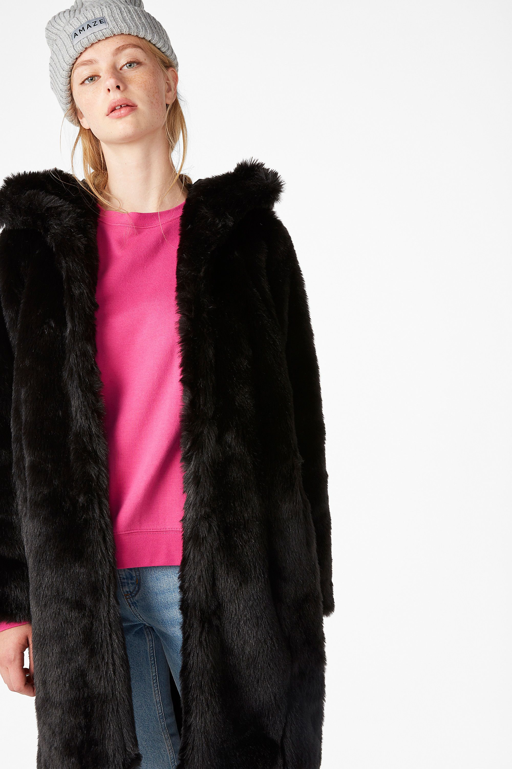 a4bf4dfeac0 <p>A legendary black faux fur coat with a fur hood - the stuff of winter  dreams! Hook and ring closures and a high neck to keep the cold out. <br  /><br />I