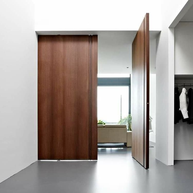 """FritsJurgens on Instagram: """"These absolutely stunning wooden pivot doors are designed by @bodor_interior_doors. The @FritsJurgens System M pivot hinge inside these…"""""""