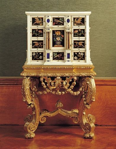 """1660-1690 German (Augsburg) Cabinet in the Royal Collection, UK - From the curators' comments: """"This cabinet, perhaps by Melchior Baumgartner (1621-86), was made both for the storage of precious objects, and as an object of wonder in itself. The hardstone panels are mostly Florentine but include some made in Prague. The date of the stand, c1690, probably indicates when the cabinet arrived in this country."""""""