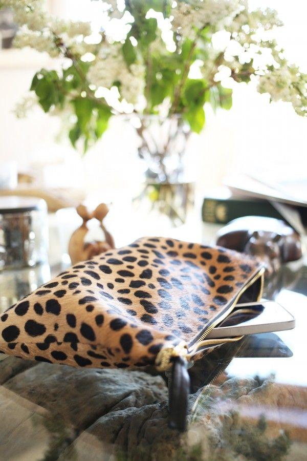 Clare Vivier clutch feat. on @Adriana Martínez Martínez Honsinger living #leopard #clutch