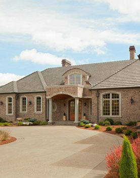 Front Elevation, Driveway, Brick, French Country: Avgerakis Collaborate + Design + Build: Joe Karman Architecture