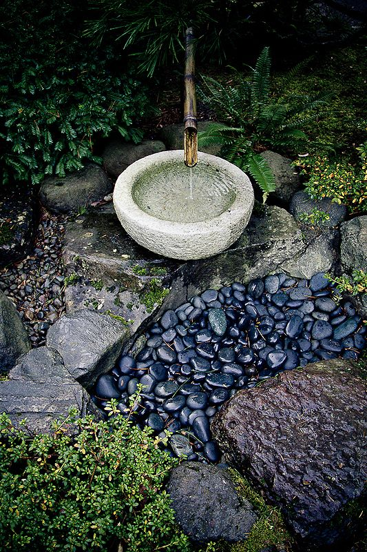 Bamboo fountain and watery rocks at the portland for Japanese bamboo water feature