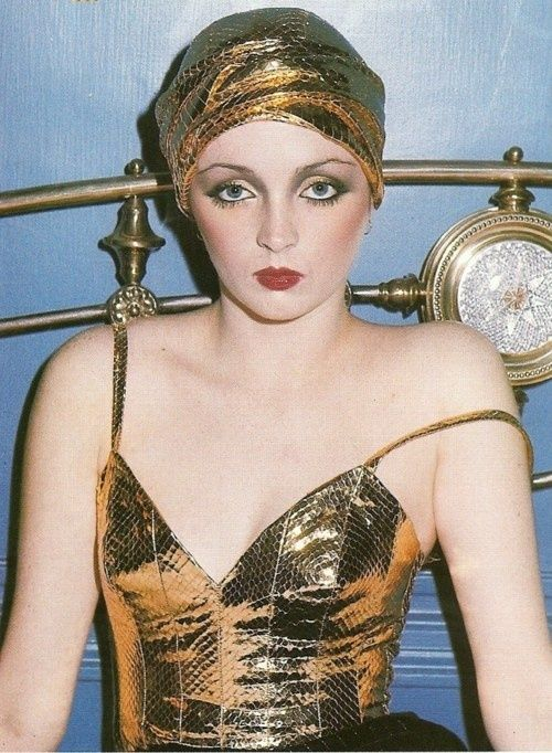 Biba makeup paired well with '70's Glitterbug fashion. Bette Midler and The Pointer Sisters were influential in starting this style.