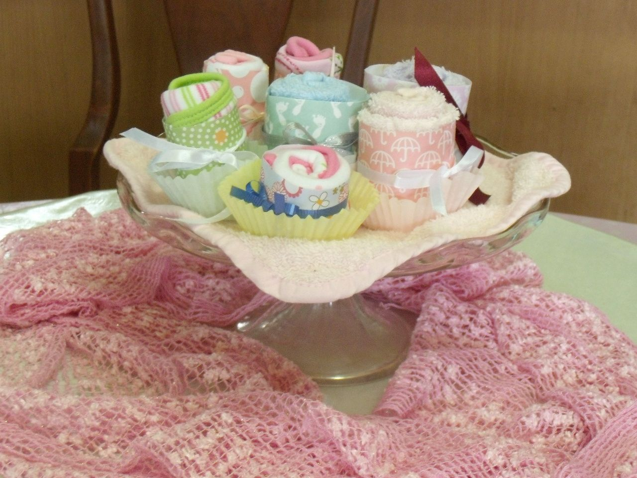 Bib and baby towel cupcakes.  So easy to make using scrapbook paper, ribbons and cupcake liner!