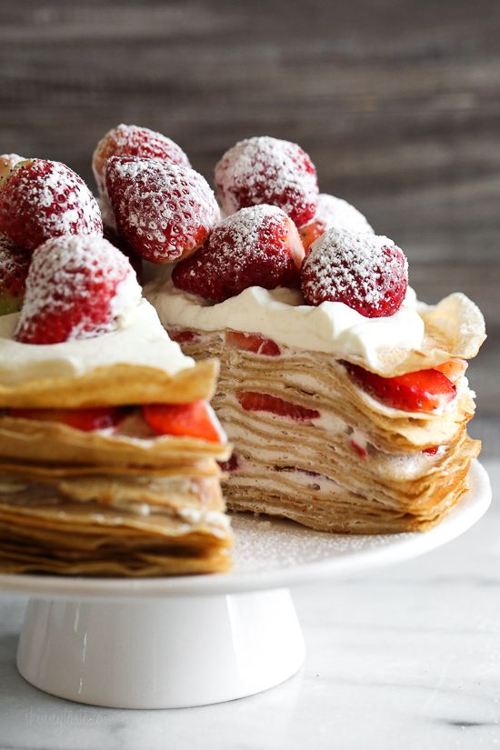 Crepes aren't just for rolling, something special happens with you layer then with cream and top them with strawberries. It creates a beautiful cake-like dessert, when you slice into it, you can see all the layers.