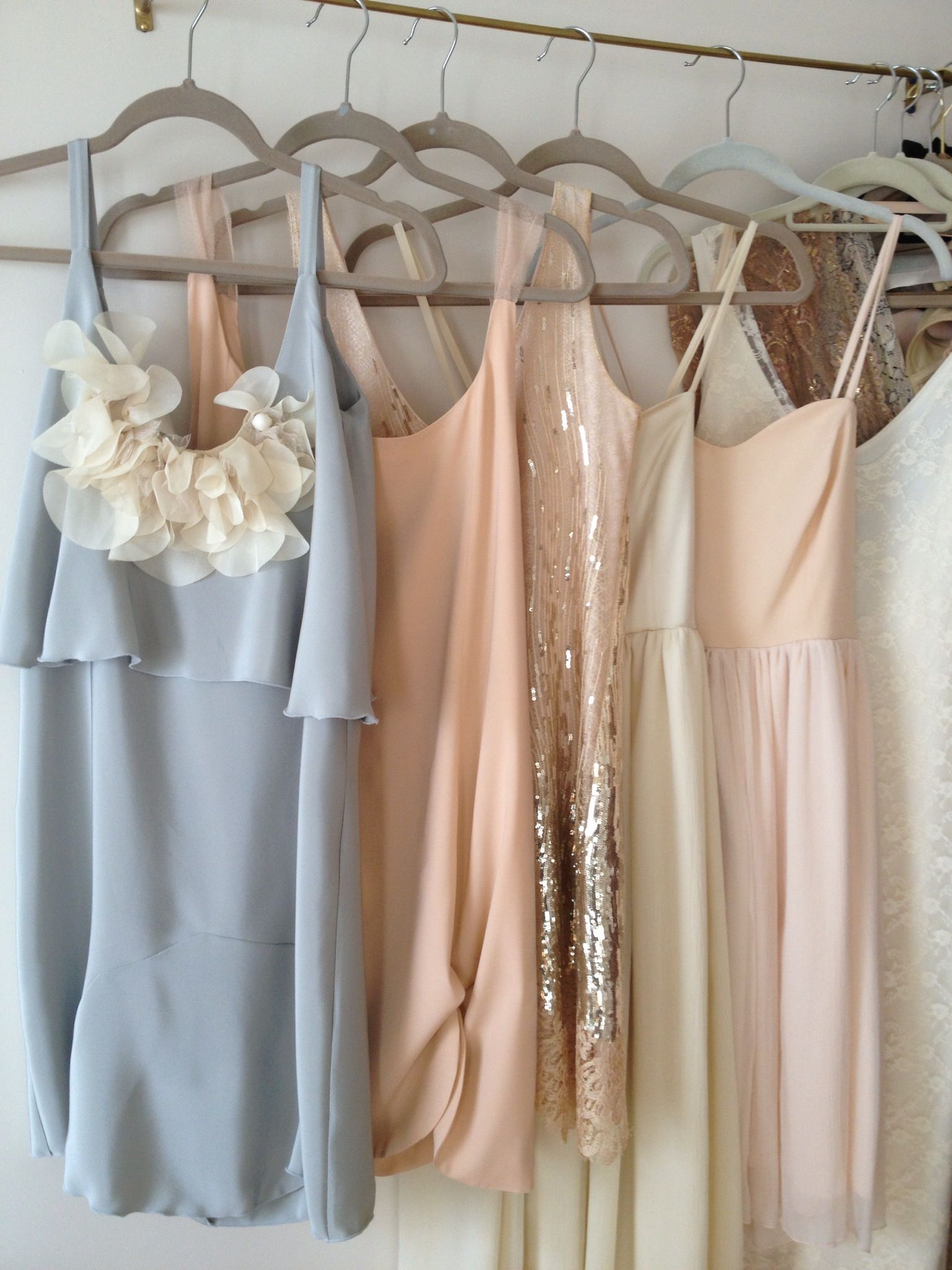 Multicolored mismatched bridesmaids dresses in gray gold blush