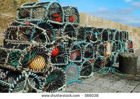 Lobster pots in Scottish fishing village - stock photo