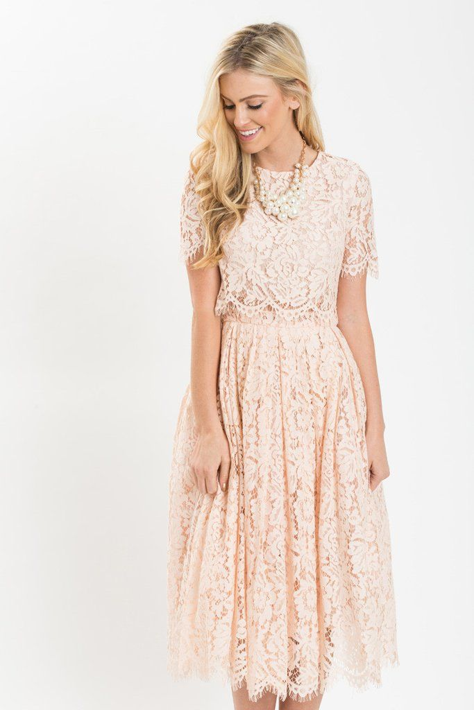 b789a235 We finally found the dress of our dreams! This short sleeve blush midi dress  is flattering, romantic, and just plain.