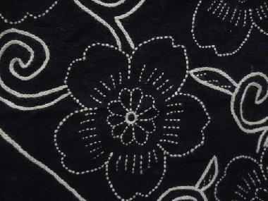 Close up of corner flower on sashiko furoshiki.