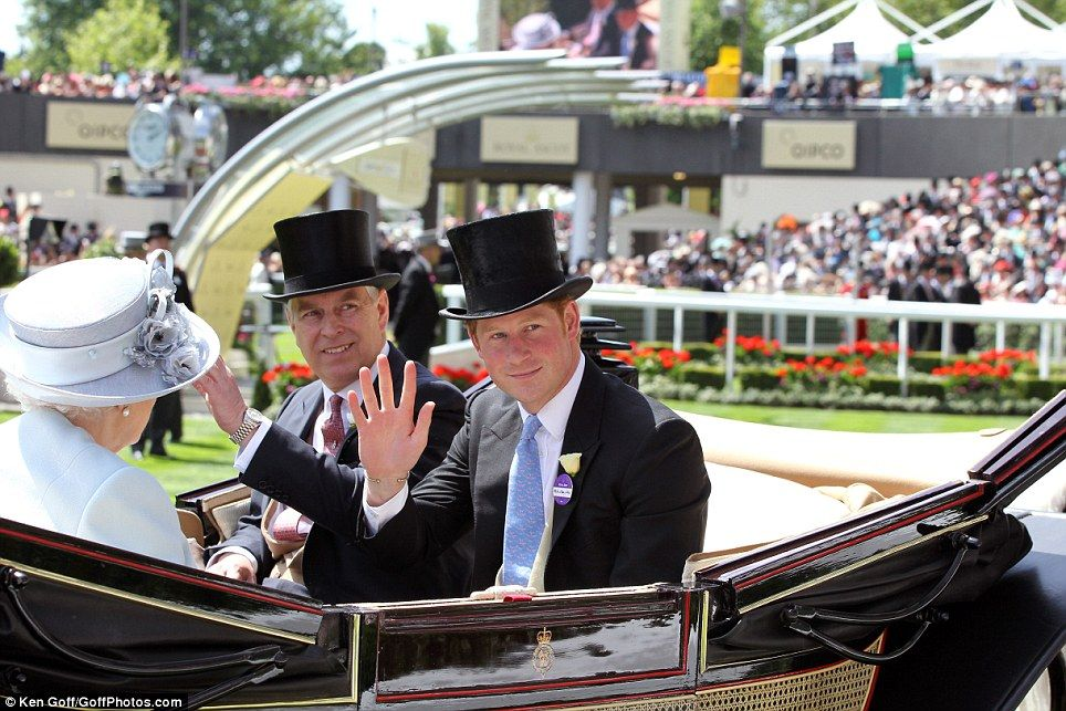 Prince Harry and Prince Andrew wave as they are driven up the racecourse with the Queen and the Duke of Edinburgh