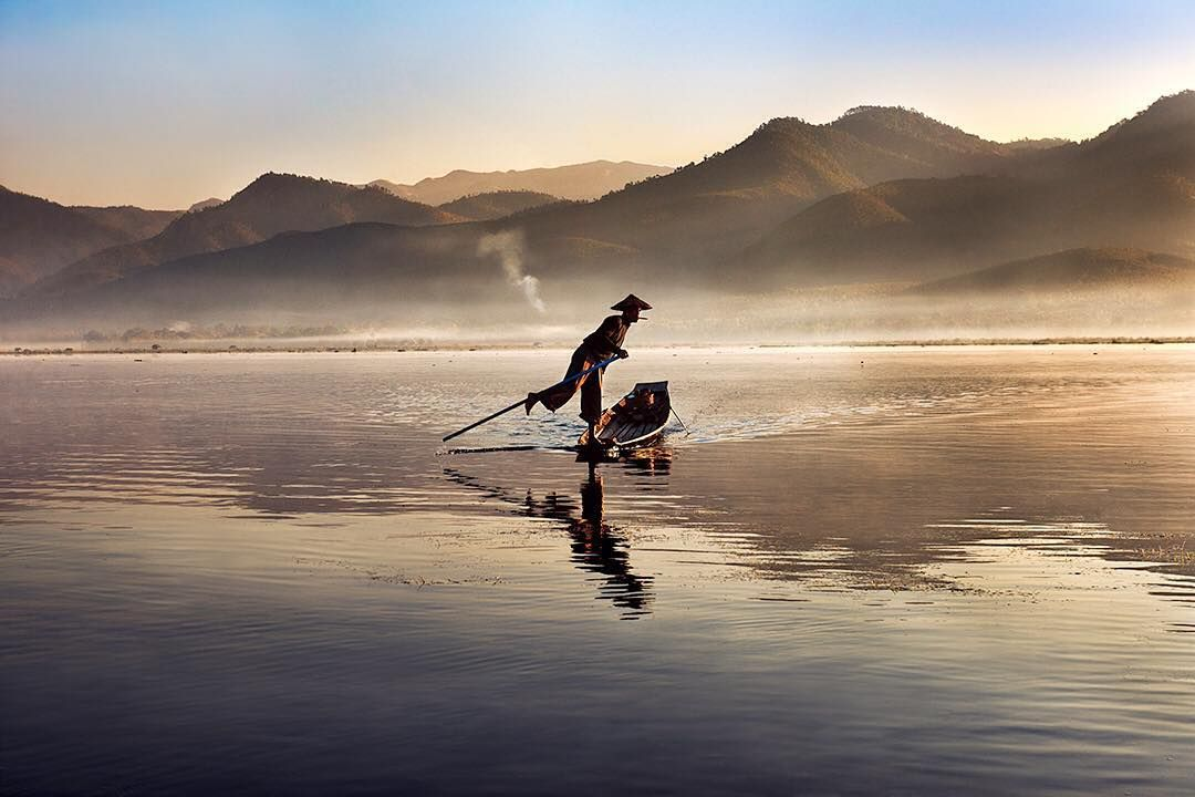 Photo by @stevemccurryofficial // An Intha fisherman paddles his boat on Inle Lake in Burma/Myanmar. Some Intha people live at the edge of the lake but others grow vegetables in floating gardens and live in houses on stilts. by natgeo