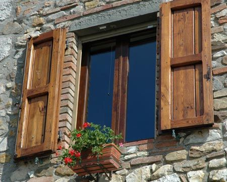 wood shutters on stone house (I would use a darker stain like ...
