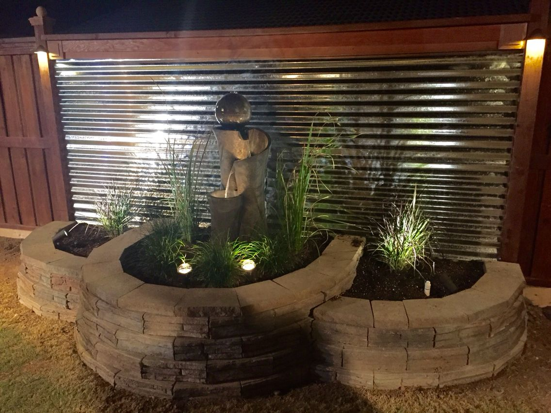 Beautiful Fountain With Corrugated Metal Backdrop