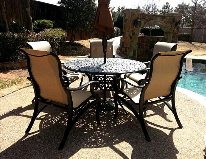 Mallin Volare Sling Dining Chairs With A Chateau Dining Table And 9 Auto Tilt Umbrella From Treasure Gard Patio Fireplace Outdoor Furniture Sets Outdoor Rooms