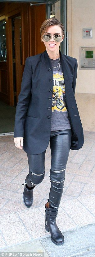 Road ready: She also rocked a vintage-style Harley Davidson T-shirt, similar to one she wo...