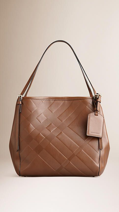 be4fd79b39ff Burberry The Small Canter in Check Embossed Leather - Elegant tote bag in  check-embossed supple leather. Refined hand-painted edges