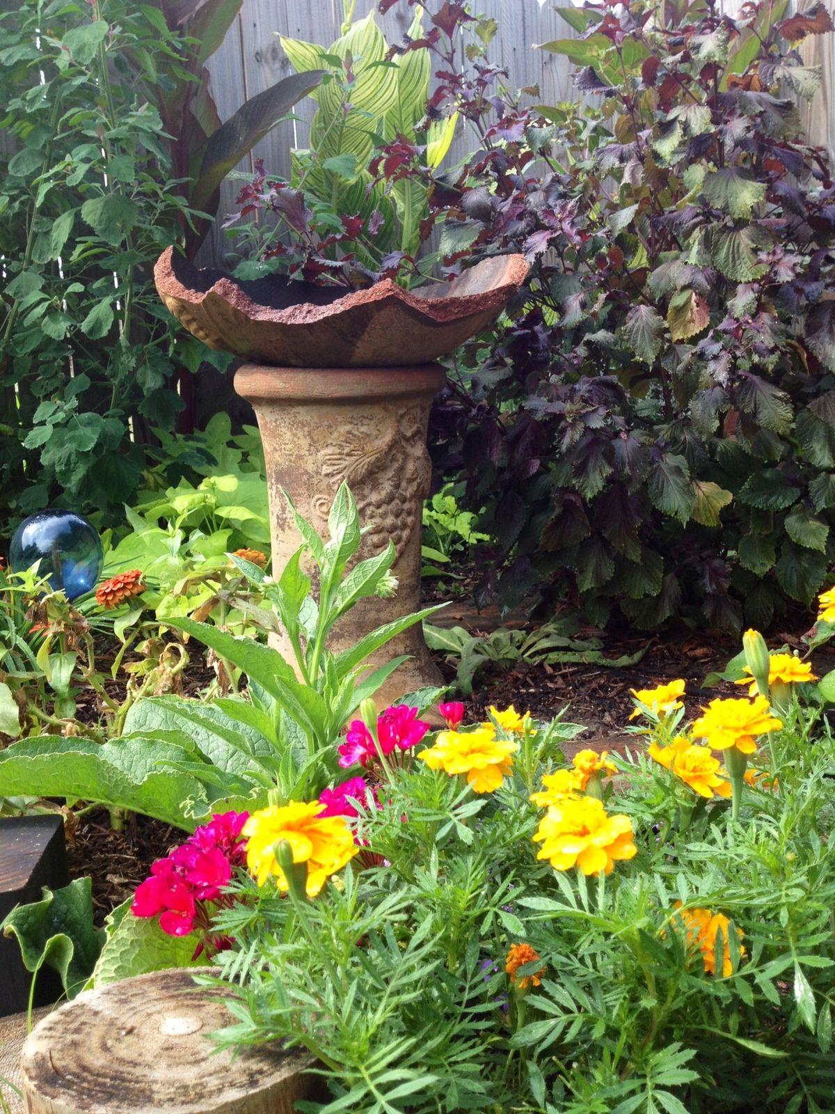 recycle a broken chiminea into a bird bath back yard