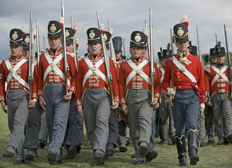 Reenactors In The Red Coated Uniform Of The 33rd Regiment Of Foot As Worn During The Napoleonic Wars Between British Army Uniform British Army Military Uniform
