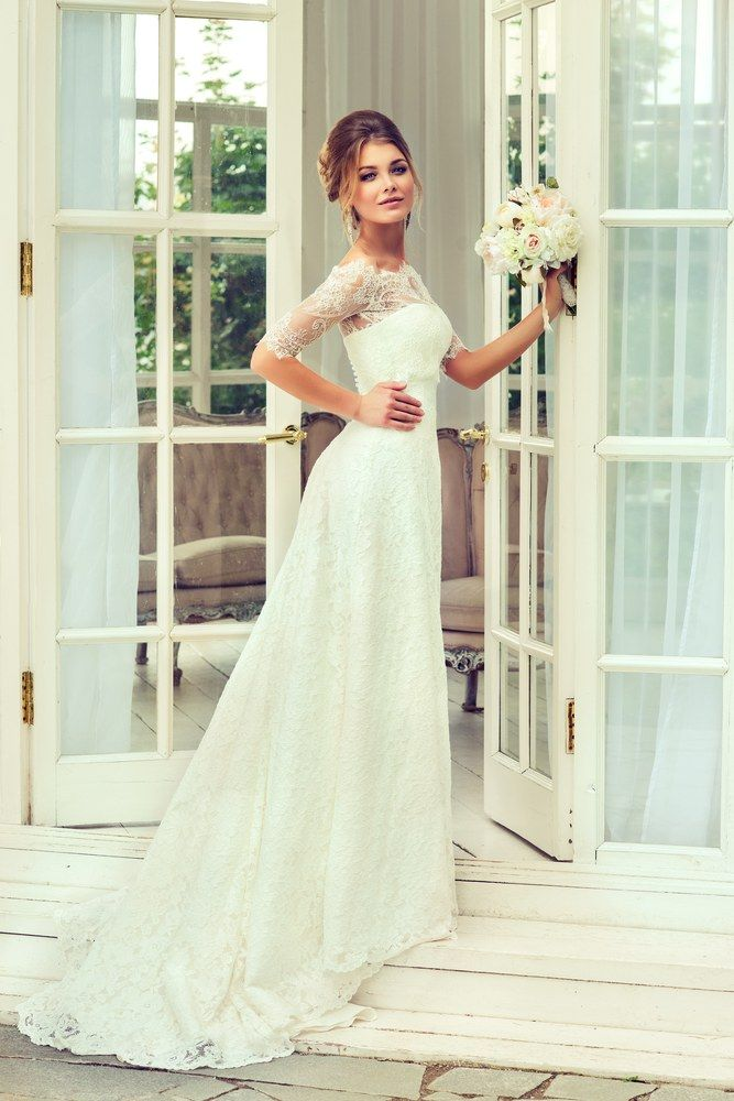 Fashion bride girl  in gorgeous wedding dress with wedding bouquet of flowers