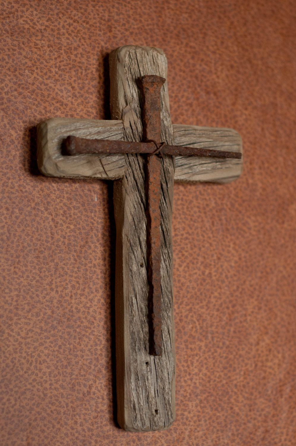 This rustic wooden cross is a handmade original design. It is made from  reclaimed barn