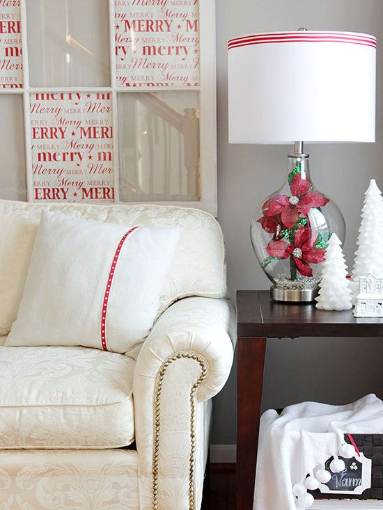 A single-color flourish can be a great way to emphasize the season. Wrap a ribbon around a pillow and lampshade, tuck cuts of wrapping paper in your color of choice behind glass or in a frame, and consider a faux flower gathering inside a lamp base or in a vase. (image credit: Cristina Garay)/