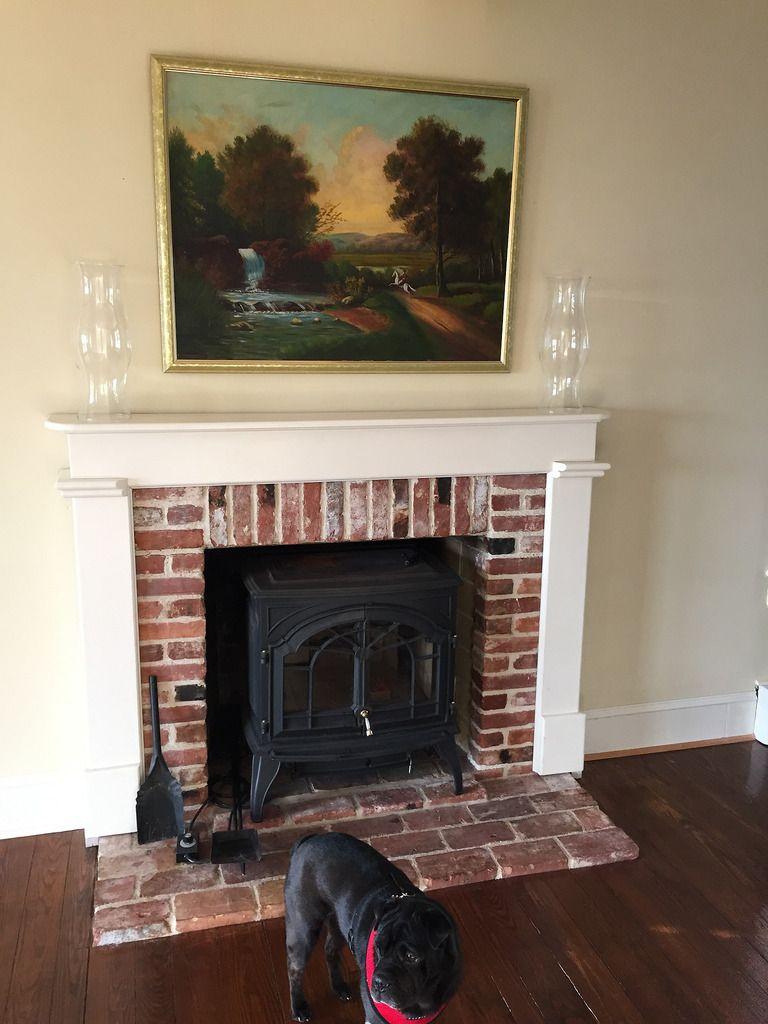 A custom diy fireplace mantel beneath our shiplap diy