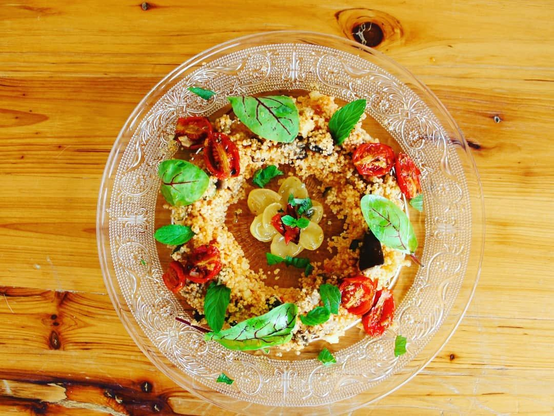Vegetable couscous: with pepper sauce, confit tomatoes and caramelized Bio grapes..