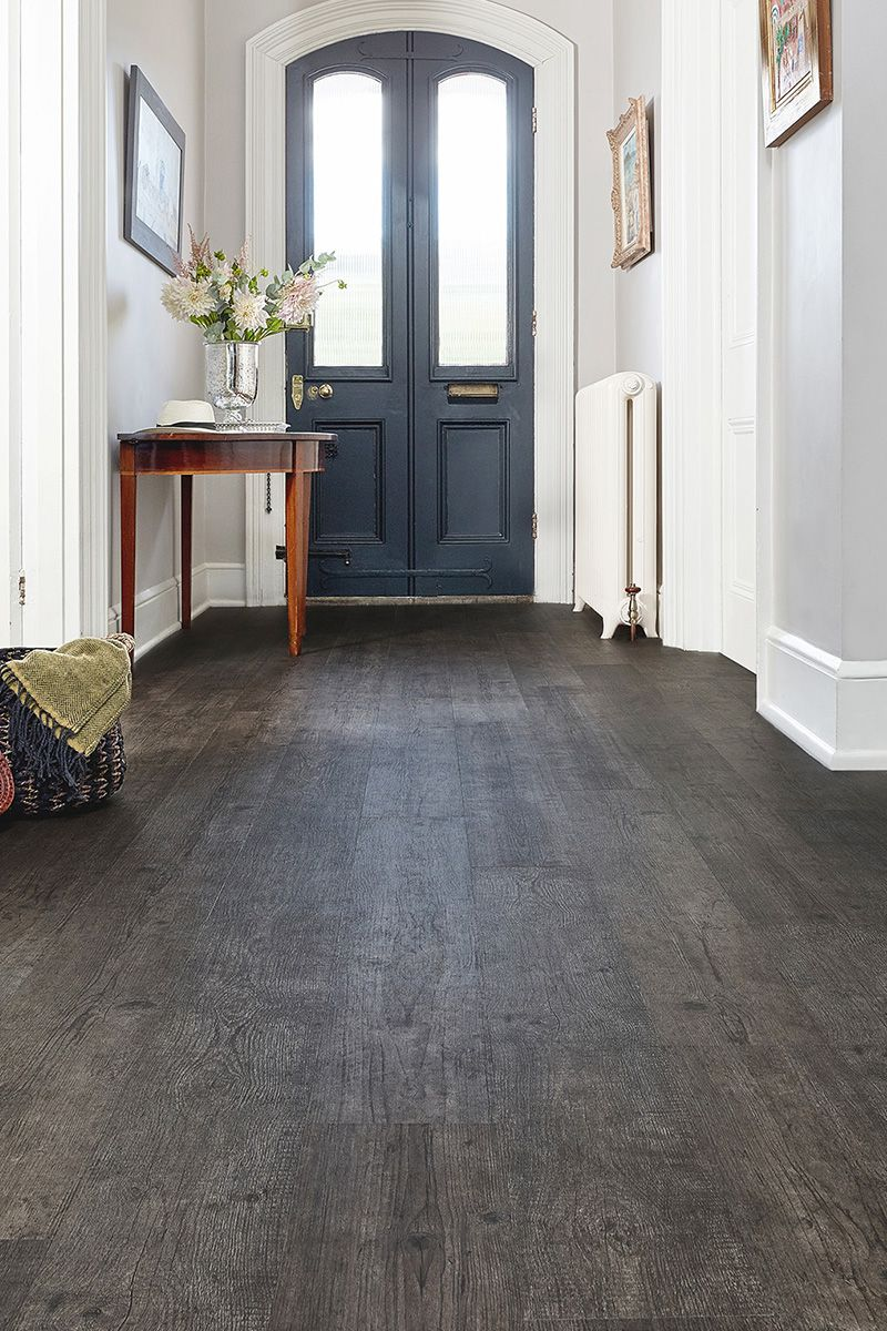 With A Deep Smoky Grey Tone And A Grain Packed Full Of Charm This Wood Effect Vinyl Plank Flo Grey Vinyl Plank Flooring Gray Wood Tile Flooring Vinyl Flooring