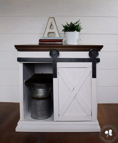 See how this old cabinet was transformed into this sliding barn door cabinet! How farmhouse chic!!