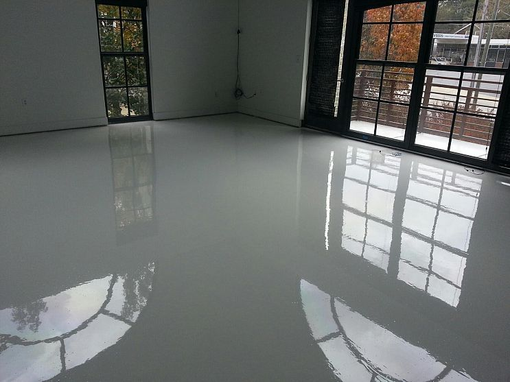 Bright white epoxy and urethane floors are being installed for How do you clean concrete floors