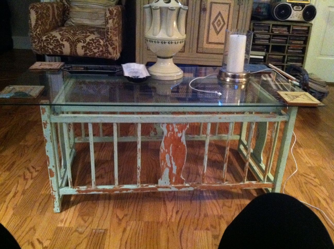 One of the very first DIY projects I did...legs cut off the vintage crib turned upside down with a piece of glass on top, instant coffee table--this has been with me for over 10 years!
