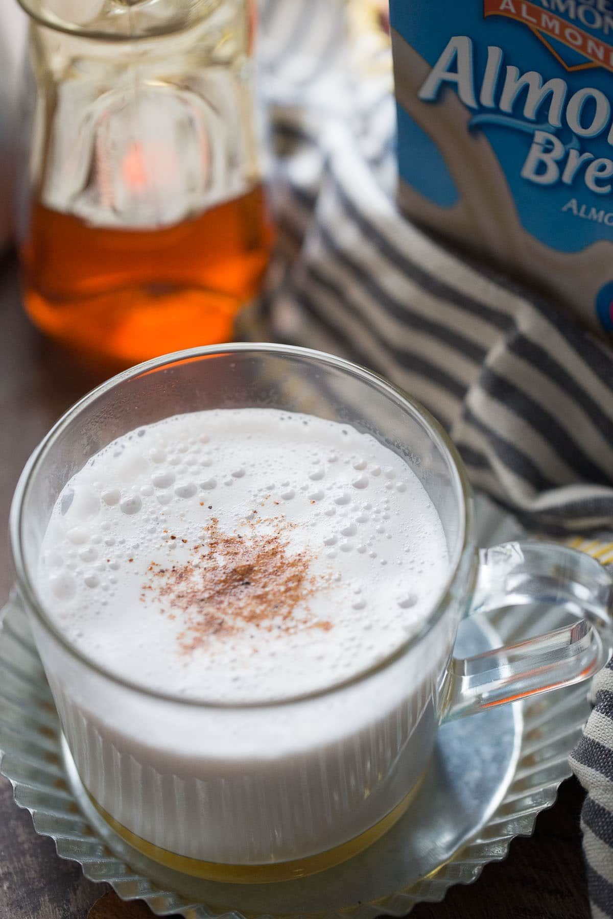 Almond milk is steamed with cinnamon, frothed and poured