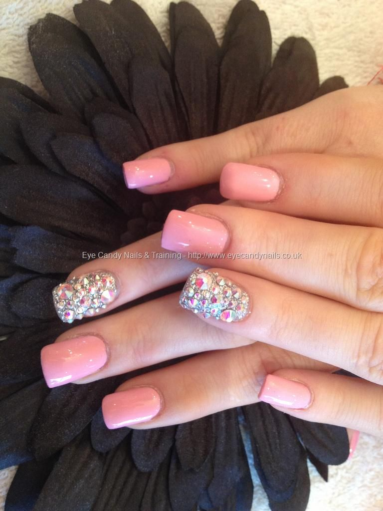 full set of acrylic with pink polish and swarovski crystals on