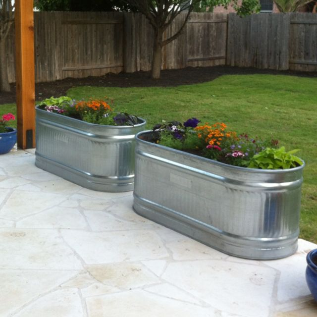 Stock Tanks For Vegetable Garden On Side Of House Flower Planters Front Porch Flowers Porch Planters