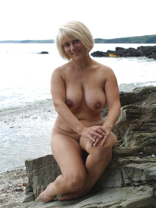 Naked men and women on nude beaches