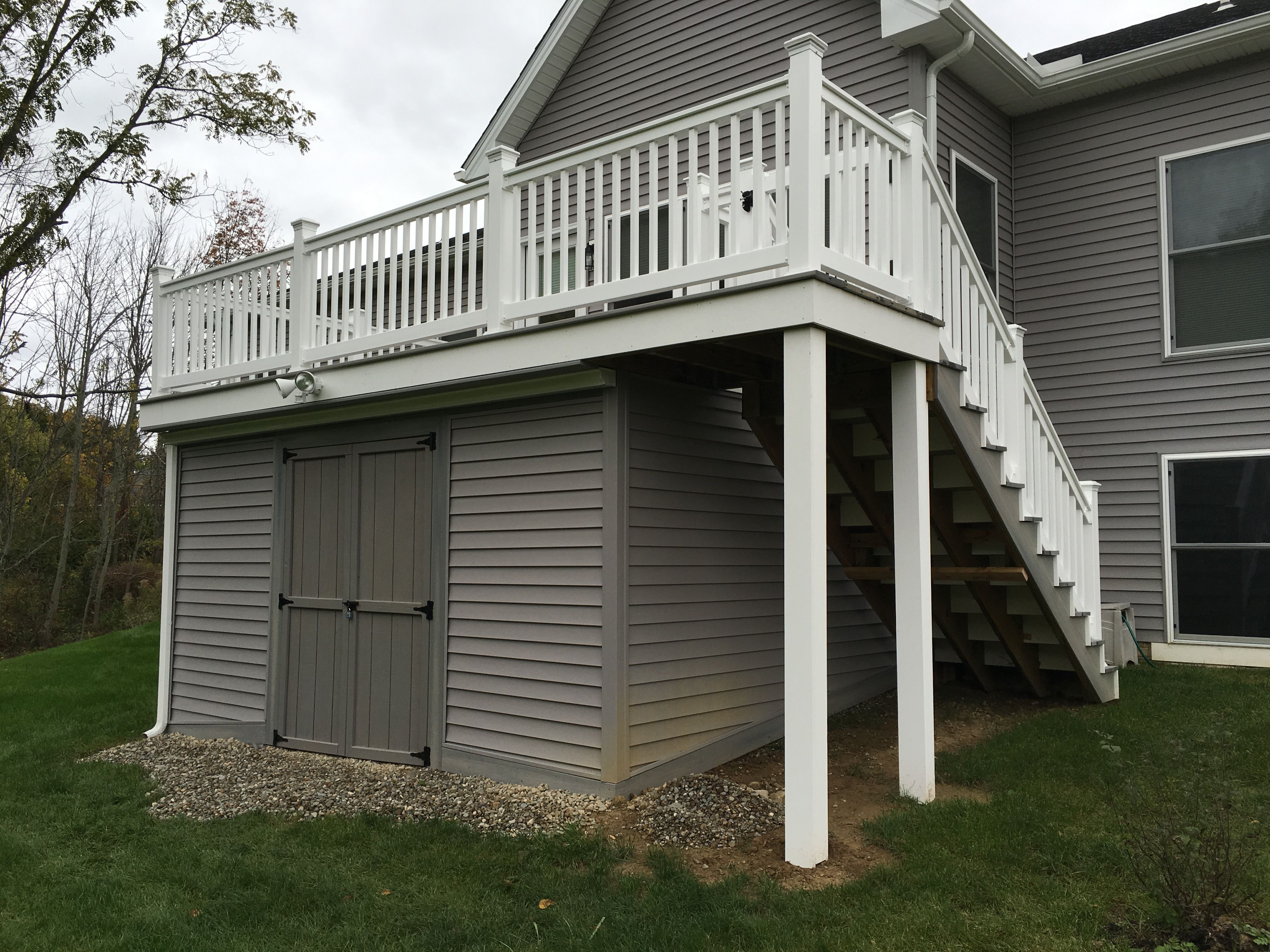 fiberon castle gray deck with storage shed under deck