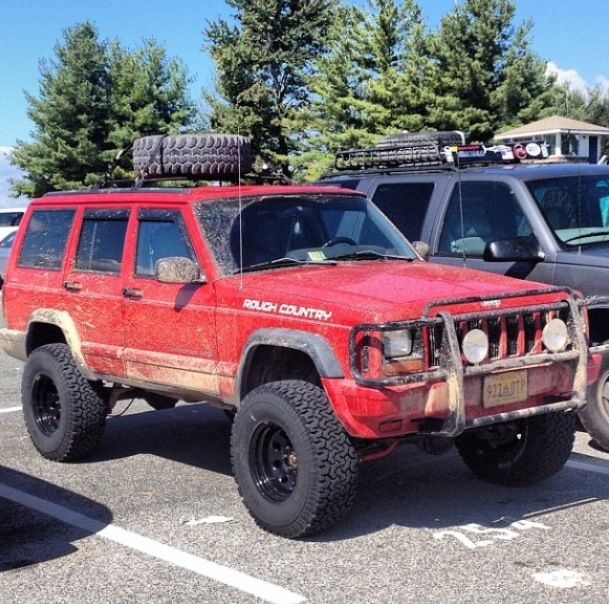This Is Exactly What Mine Will Look Like 1999 Jeep Cherokee Sport Red 4 Doors Lifted Snow Tires Grill Jeep Cherokee Jeep Cherokee Sport Jeep Xj