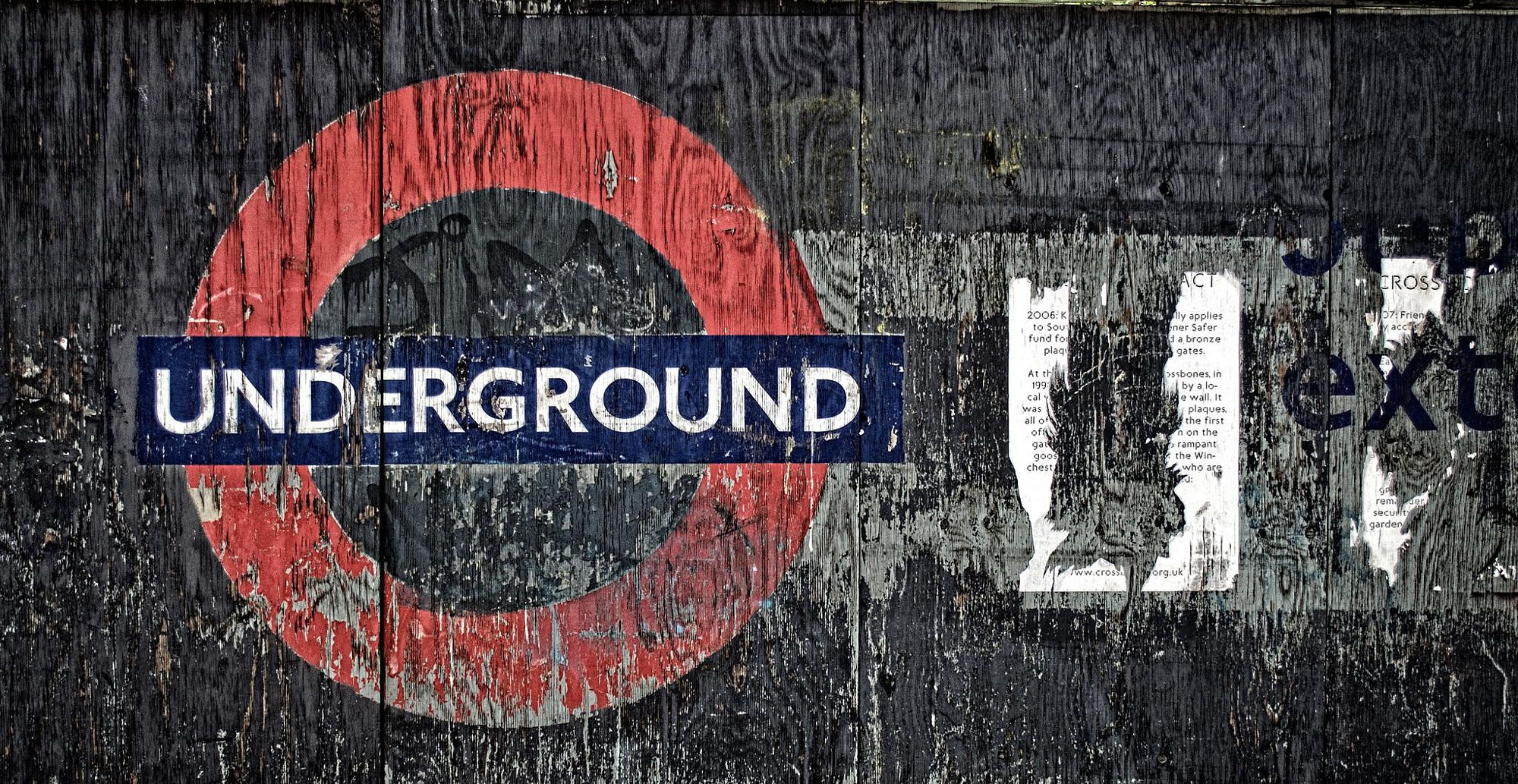 An old sign showing where Underground work had once been carried out next to the Cross Bones graveyard for the 'The Outcast Dead'.  http://www.crossbones.org.uk/