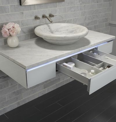 this Robern Vanity is a white marble vanity with makeup drawer ...