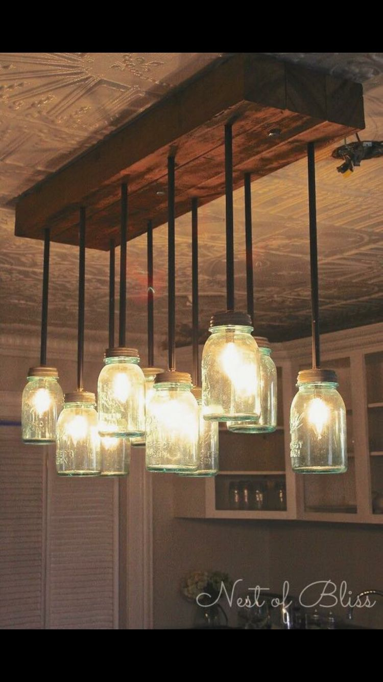 Kitchen idea farmhouse rental pinterest kitchens lights and house lots of creative ideas and tutorials including this diy mason jar chandelier by nest of bliss dont like the mason jars but could use thrifted globes arubaitofo Gallery