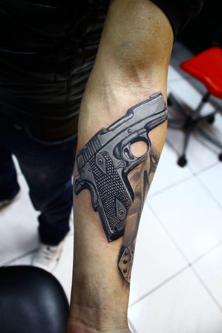 realistic gun tattoo ideas design on arm. Black Bedroom Furniture Sets. Home Design Ideas