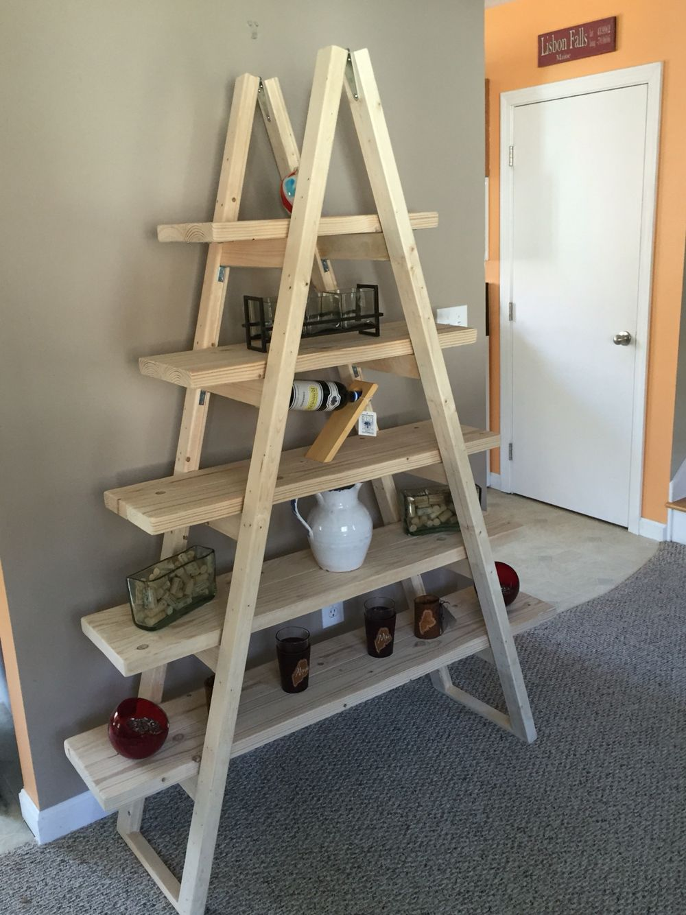 An a-frame shelf built for form and function.  This unfinished shelf will fit into any room and can be finished to match your decor.