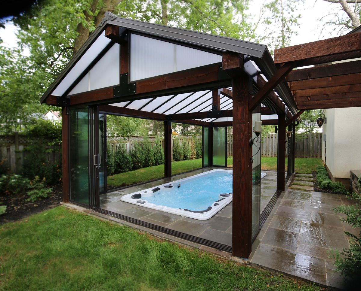 A 19fx Self Cleaning Swim Spa From Hydropool Enclosed In A Custom Sunroom For Year Round Use Indoor Swim Spa Pool Houses Spa Rooms