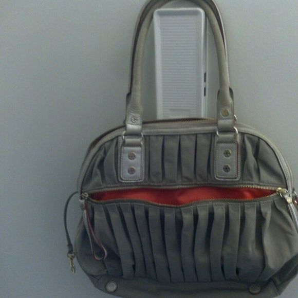 M Z Wallace.. Price is firm for sale Nylon bag with red satin lining, zipped inside pocket, outside pocket on front & back. Normal wear on bag lots of life left. Inside attached key fab. Bag has logo throughout hardware... M Z Wallace Bags Shoulder Bags